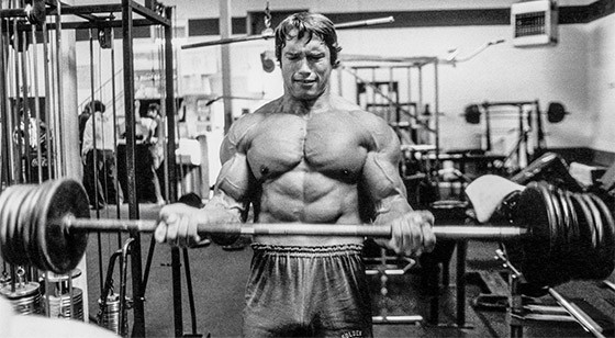 arnold using barbell